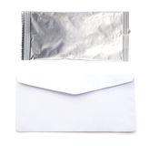 Envelope and foil package isolate. Envelope and foil package isolate Royalty Free Stock Photos
