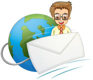 An envelope in front of a smiling businessman above the globe Stock Image