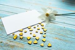 Envelope with golden hearts and a flower daffodil flower on the table. Mothers Day. Valentine`s Day. Love concept. Gift, message f royalty free stock photo