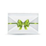 Envelope with green bow  on white Stock Photo