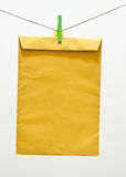 Envelope and green clothespin Royalty Free Stock Images