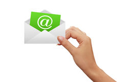 Envelope and green e-mail in the hand Royalty Free Stock Photos