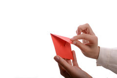 Envelope in hand. Hand holding a red envelope on a white background Royalty Free Stock Photography