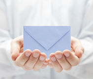 Envelope in hands Royalty Free Stock Photos