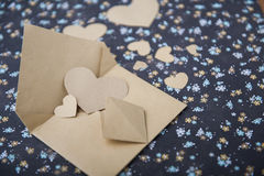 Envelope and heart on a floral background, love letter, valentine`s confession Stock Image