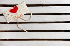 Envelope with heart on white wooden background Stock Images
