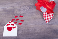 Envelope with hearts with a gift Stock Photography