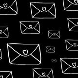 Envelope with hearts pattern on black Royalty Free Stock Photo