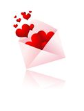 Envelope with hearts popping out Royalty Free Stock Photography