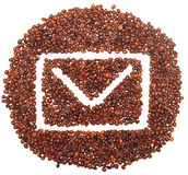 Envelope icon is lined with coffee beans Stock Photography
