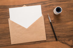 Envelope, ink pen, inkwell Stock Photo
