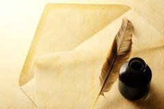 Envelope with inkwell and feather Stock Photos
