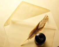 Envelope with inkwell and feather Royalty Free Stock Photos