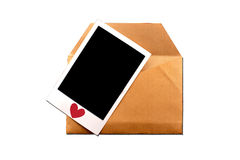 Envelope with instant photo Royalty Free Stock Image