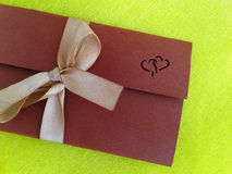 Envelope with the invitation. Brown, close-up Royalty Free Stock Photography