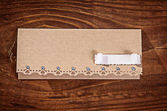 Envelope for invitation on wooden table Royalty Free Stock Photo
