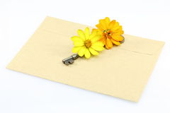 Envelope with key and flower Royalty Free Stock Image