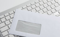 Envelope and Keyboard. The image shows a keyboard and a envelope Royalty Free Stock Image