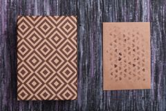Envelope of Kraft paper. Love letter envelope. Wooden background. A holiday gift box. Gift with the letter. royalty free stock image