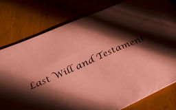 Envelope with last will and testament. Will and testament written on an envelope stock images