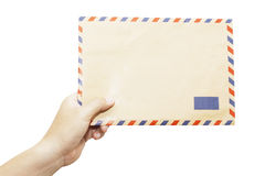 Envelope in the left hand Royalty Free Stock Images