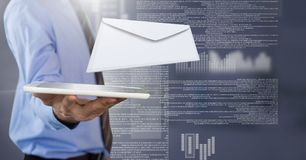 Envelope letter message and man using tablet stock images