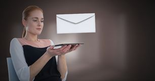 Envelope letter message and woman using tablet royalty free stock photography