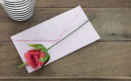 Envelope letter with rose. Stock Photos