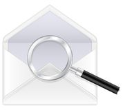 Envelope and magnifier Stock Images