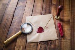 Envelope, magnifier, seal Stock Photos