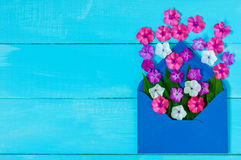 Envelope Mail, Blue cover with many little flowers on wooden Background. Valentine Day Card, Love or Wedding Greeting Stock Image