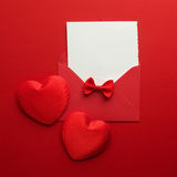 Envelope Mail, Heart and Ribbon on red Background. Valentine Day Card, Love or Wedding Greeting Concept. Top view Stock Photos