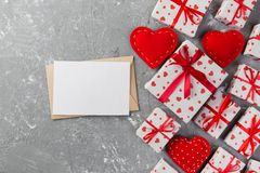 Envelope Mail with Red Heart and gift box over grey cement Background. Valentine Day Card, Love or Wedding Greeting Concept.  royalty free stock images