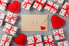 Envelope Mail with Red Heart and gift box over grey cement Background. Valentine Day Card, Love or Wedding Greeting Concept.  royalty free stock photography