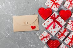 Envelope Mail with Red Heart and gift box over grey cement Background. Valentine Day Card, Love or Wedding Greeting Concept.  stock photography