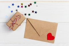 Envelope Mail with Red Heart and gift box over White Wooden Background. Valentine Day Card, Love or Wedding Greeting Concept Stock Photos