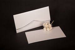 Envelope and mail wedding invitations on black Royalty Free Stock Images
