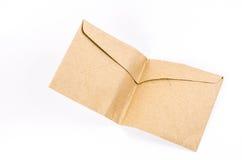 Envelope marrom dobrado no fundo branco Imagem de Stock