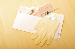 Envelope and medical supplies Royalty Free Stock Image