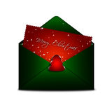 Envelope with merry christmas card over white background Stock Photo