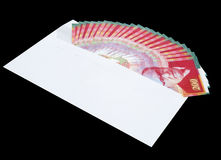 An envelope with money, bills of NIS 200. White envelope with money, bills of NIS 200 on a black background Stock Photo