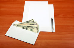 Envelope with a Money and Empty Paper Royalty Free Stock Photo