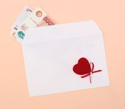 Envelope with money and heart Royalty Free Stock Photography