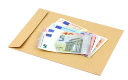Envelope and money on a white background Royalty Free Stock Photos