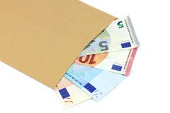 Envelope and money on a white background. Royalty Free Stock Images