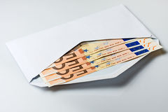 Envelope with Money. White open envelope with 50 euro banknotes inside Stock Images