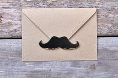 Envelope with mustache. Stock Photos