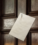 Envelope nailed to wooden door Royalty Free Stock Photography