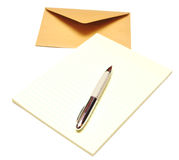 Envelope with notepad and pen Royalty Free Stock Photo