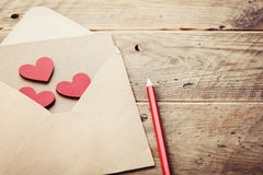 Free Envelope Or Letter And Red Hearts On Rustic Table For Love Message On Valentines Day In Retro Toning. Stock Photos - 83479653
